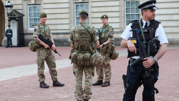 Image result for buckingham palace armed police
